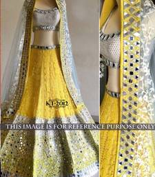 Buy Yellow embroidered net unstitched lehenga bridal-lehenga online