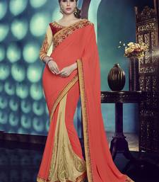 Buy Coral embroidered crepe saree with blouse half-saree online