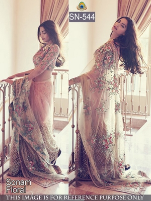 Light pink embroidered net saree with blouse