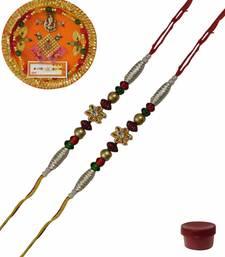 Buy Graceful of two fancy rakhis with thali fancy-rakhi online