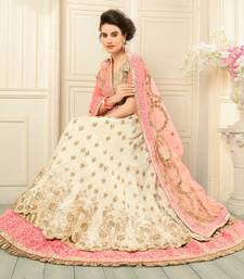 Buy Beige embroidered silk semi stitched lehenga wedding-season-sale online
