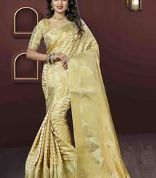 Buy Beige woven jacquard saree with blouse jacquard-saree online