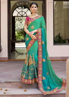 Teal embroidered art silk saree with blouse