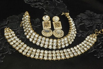 Gold Plated Handcrafted White colour Earrings &  Jodha Akbar Anklets