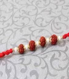Buy Rudraksha and Pearl Beads Rakhi rudraksha-rakhi online