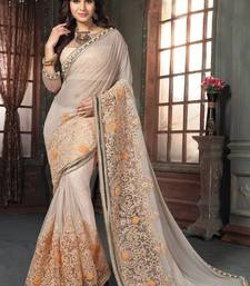 Buy Light peach embroidered lycra saree with blouse wedding-saree online