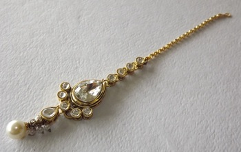 Golden Traditional Maang Tikka studed with American Diamonds