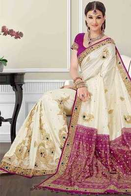 Beige silk zari & stone worked saree in purple zari & stone worked pallu