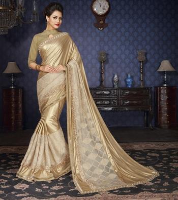 Beige Embellished Lycra saree with blouse