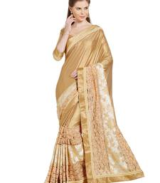 Buy golden floral design and moti and stone synthetic fabrics saree with blouse heavy-work-saree online
