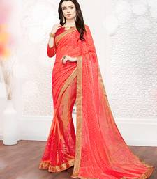 Buy Orange printed brasso saree with blouse brasso-saree online