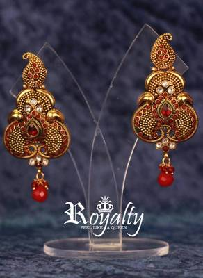 Royal Gold Plated Earrings studded with Simulated Gemstones and Simulated Golden Yellow dangling beads