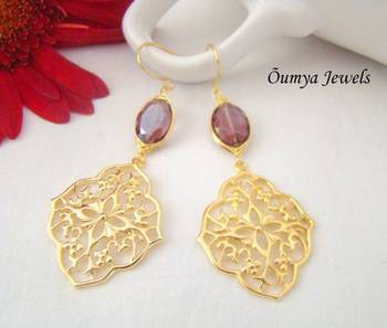 Oriental earrings with amethyst coloured stone
